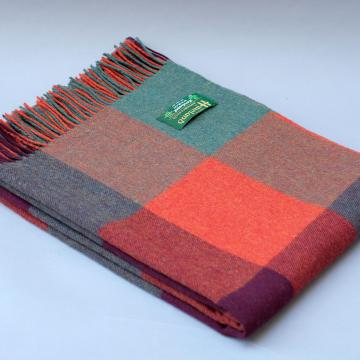 John Hanly Lambswool blanket in Orange Green and Purple Block Check