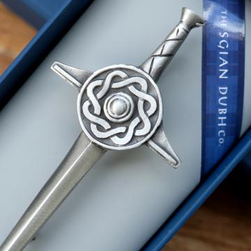 Antique pewter sword kilt pin with round celtic emblem