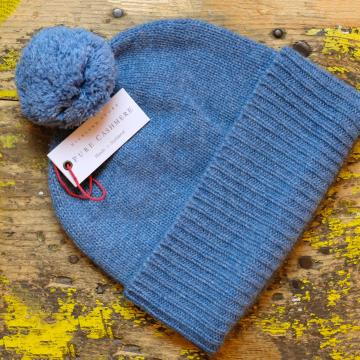 Soft, elegant and warm pure cashmere hat with pom pom.  Made in Scotland.