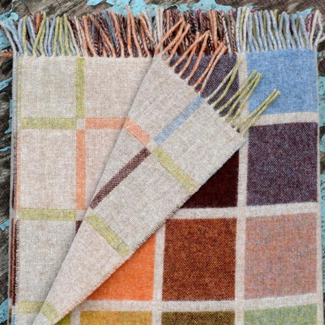 Beige lambswool blanket in multi coloured tile pattern